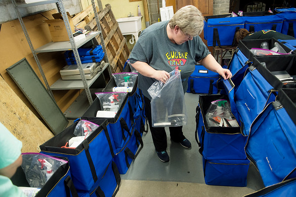Patty Moss, deputy clerk for Jasper County, helps put together a sanitation kit for a polling place in preparation for Tuesday's elections on Thursday at the Jasper County Records Center. Globe | Roger Nomer