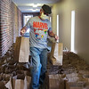 Nick Jordan works with food donations on May 1 at Riverton First Baptist Church.<br /> Globe | Roger Nomer