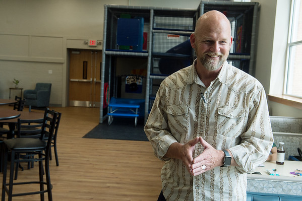 James Whitford, executive director of Watered Gardens, talks about the history of renovating Washington School into Washington Hope Center on Tuesday. Globe | Roger Nomer