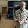 James Whitford, executive director of Watered Gardens, talks about the history of renovating Washington School into Washington Hope Center on Tuesday.<br /> Globe | Roger Nomer