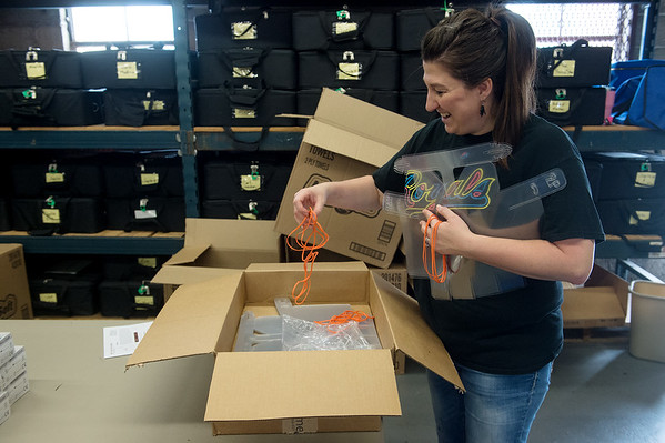 Shala Cochrane, deputy clerk for Jasper County, distributes face shields for sanitation kits for polling places in preparation for Tuesday's elections on Thursday at the Jasper County Records Center. Globe | Roger Nomer