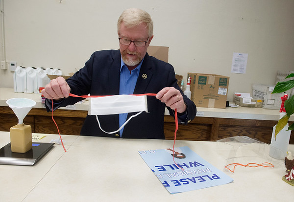 Charlie Davis, Jasper County Clerk, talks about a facemask that will be available to poll workers on Wednesday at the Jasper County Courthouse in Carthage. Globe | Roger Nomer