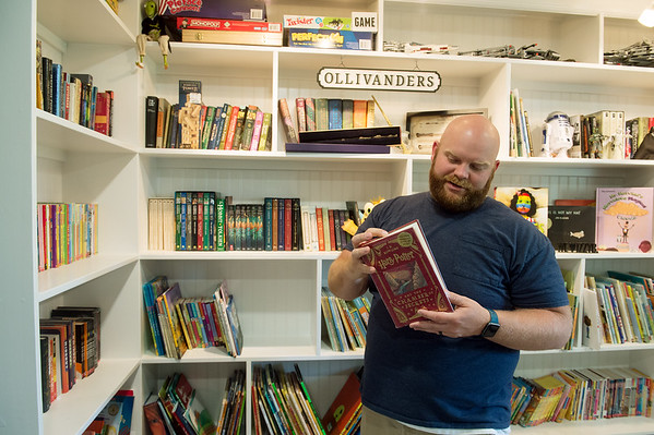 Isaiah Basye talks about his rebuild library and one of his favorite books salvaged from the 2019 Carl Junction tornado during an interview on Thursday. Globe   Roger Nomer