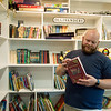 Isaiah Basye talks about his rebuild library and one of his favorite books salvaged from the 2019 Carl Junction tornado during an interview on Thursday.<br /> Globe | Roger Nomer