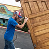 Jeremiah Taylor, co-owner of Taylor Brothers Construction, lifts one of the original Schifferdecker House doors at Del Rio on Thursday.<br /> Globe | Roger Nomer