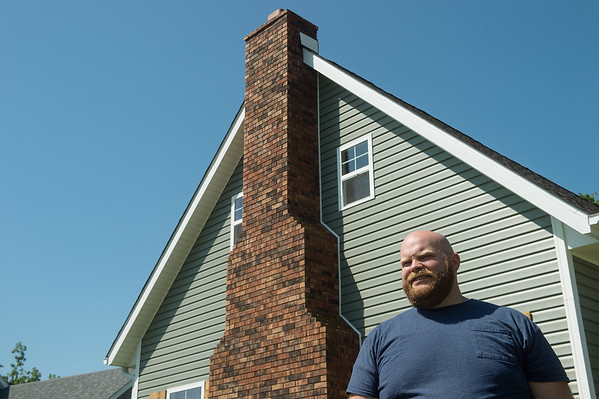 Isaiah Basye talks about his chimney, which is the only structure of his house to survive the 2019 Carl Junction tornado, during an interview on Thursday. Globe | Roger Nomer