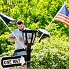 BEN GARVER — THE BERKSHIRE EAGLE<br /> Mike Zaroba of Henry's Electric in Lee fixes a period streetlamp on Main Street near Town Hall, Monday, July 1, 2019.