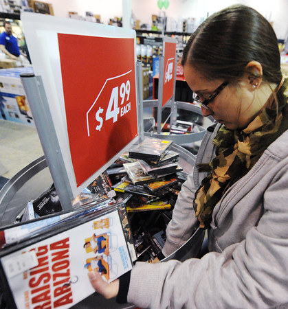 Globe/T. Rob Brown<br /> Amanda Coy, of Joplin, looks through a movie bargain bin Friday morning, Nov. 23, 2012, during Black Friday sales at Best Buy. Coy said she was looking for a particular movie that was in the advertisement.
