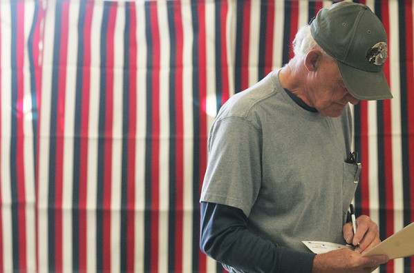 Globe/Roger Nomer<br /> Don Cure, Galena, votes at Galena City Hall on Tuesday morning.