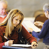 Globe/T. Rob Brown<br /> Due to high voter turnout, Holly Hukill, and other Carl Junction voters are forced to vote on tables instead of in voting booths Tuesday afternoon, Nov. 6, 2012, at the Briarbrook Country Club polling location.