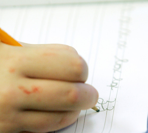 Globe/Roger Nomer<br /> Madison Nelson, third grade, practices her cursive Z during class at Columbia elementary on Wednesday.