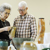 Globe/T. Rob Brown<br /> Ann and Lee Haggard, of Carthage, peruse the stonewares Friday afternoon, Nov. 16, 2012, during the Midwest Clay Artists Pottery Show & Sale at City Pointe Shopping Center on Madison in Webb City.