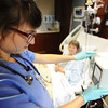 Globe/T. Rob Brown<br /> Freeman Health System nurse Jenna McCarty, R.N., of Pittsburg, Kan., checks the IV settings for patient Barbara Turner-Tucker, of Joplin, in her room at Freeman West Thursday afternoon, Nov. 8, 2012.