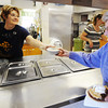 Globe/T. Rob Brown<br /> Dessert in hand, Joy Russell, of Joplin, gets a bowl of clam chowder from Connie LeMaster, of Joplin, a church member, Saturday morning, Nov. 10, 2012, during the St. Philips Episcopal Church's bazaar.