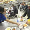Globe/Roger Nomer<br /> Caitlin Brock, sophomore, serves Tye Zola, Neosho, a plate of pancakes during Thursday's community breakfast at Diamond High School.  Diamond High School students from the National Honor Society and Student Council held the breakfast to show their appreciation for the community's support.