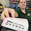 Globe/T. Rob Brown<br /> Andrea Wagner of Carterville, assistant manager for the Snak Atak on North Main Street in Joplin, pulls a customer's PowerBall ticket purchase off the store's printer Tuesday afternoon, Nov. 27, 2012.