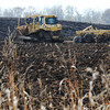 Globe/T. Rob Brown<br /> Dale Cullison, dozer operator with KAT Excavation of Bates City, pulls a plow disc over a field of mud Tuesday afternoon, Nov. 13, 2012, to help dry it so work can continue on the land at the southwest corner of East 32nd Street and Kodiak Road, at the Crossroads Industrial Park.