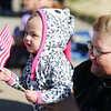 Globe/T. Rob Brown<br /> One-year-old Khloe Martin, gets a lift from grandma Sherri Phillips, both of Joplin, so she can better see the 25th Annual Veteran's Day Parade Saturday morning, Nov. 10, 2012, on Main Street in downtown Joplin.