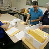 Globe/Roger Nomer<br /> (from left) Mary Sargent, Donna Turner and Carol Reed organize recovered photos at the First Baptist Church in Carthage on Thursday.