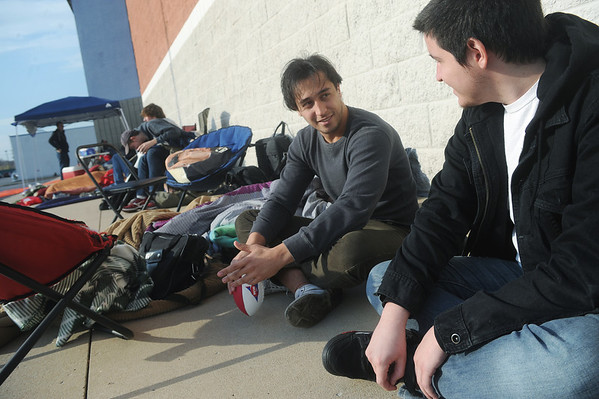 Globe/Roger Nomer<br /> Wander Goda, Sao Paulo, Brazil, left, and Joseph Gammill, Joplin, talk while waiting in line at Best Buy  on Thursday afternoon.  Goda, sophomore at Crowder College in Neosho, and Gammill, who was planning on selling his spot in line, had never met before Thursday.