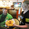 Globe/T. Rob Brown<br /> Buffalo Wild Wings server Ashley Stephens, of Joplin, delivers an order of nachos with chili con queso sauce to customer Chris Belk, of rural Joplin, Tuesday afternoon, Nov. 6, 2012.