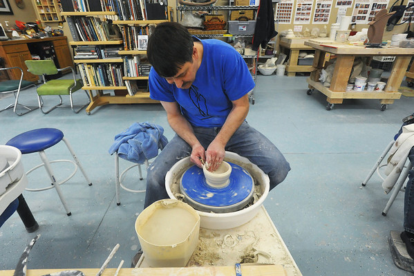 Globe/Roger Nomer<br /> Brent Skinner works on a wheel at Phoenix Fired Art on Tuesday afternoon.