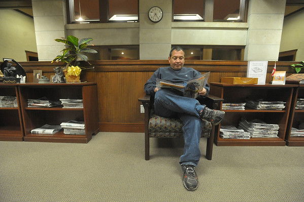Globe/Roger Nomer<br /> Pat Valdez reads during an evening at the Pittsburg Public Library on Thursday, Nov. 15, 2012.