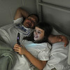 Globe/Roger Nomer<br /> Pat and Sami, 8, Valdez play a game on the family's cell phone before bedtime at the CHOICES Emergency Shelter in Pittsburg on Tuesday, Nov. 15, 2012.