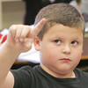 Globe/Roger Nomer<br /> Tyler Peck, third grade, traces a cursive letter in the air during an exercise at Columbia Elementary on Wednesday afternoon.