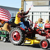 Globe/T. Rob Brown<br /> The Lion's Club entry in the 25th Annual Veteran's Day Parade Saturday morning, Nov. 10, 2012, on Main Street in downtown Joplin.