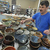 Globe/Roger Nomer<br /> Brent Skinner sorts through the empty bowls at Phoenix Fired Art on Tuesday afternoon.