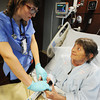 Globe/T. Rob Brown<br /> Freeman Health System patient Barbara Turner-Tucker, of Joplin, looks up at nurse Jenna McCarty, R.N., of Pittsburg, Kan., as she checks on her in her room at Freeman West Thursday afternoon, Nov. 8, 2012.