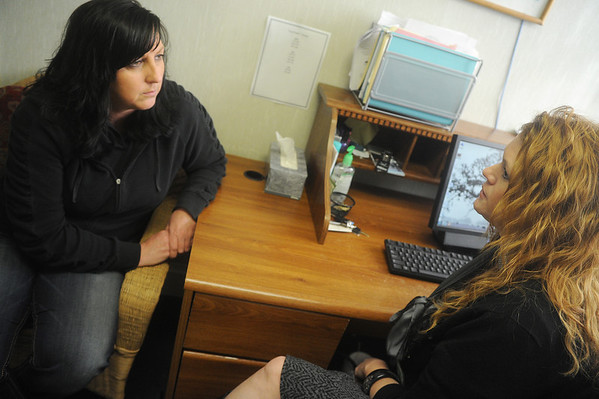 Globe/Roger Nomer<br /> Amy Lane, left, development coordinator, and Heather Wyrick, emergency service specialist, talk while working at Lafayette House on Wednesday.