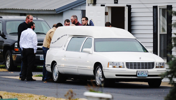 Globe/T. Rob Brown<br /> Pallbearers place the body into a hearse following funeral services Monday afternoon, Nov. 26, 2012, at McQueen's Funeral Home on W Highway in Wheaton. The funeral procession went to Monett.