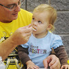 Globe/Roger Nomer<br /> Jeff Jinks, Diamond, feeds his granddaughter Sydnee Jinks, 1, a pancake during a community breakfast at Diamond High School on Thursday morning.  Diamond High School students from the National Honor Society and Student Council held the breakfast to show their appreciation for the community's support.