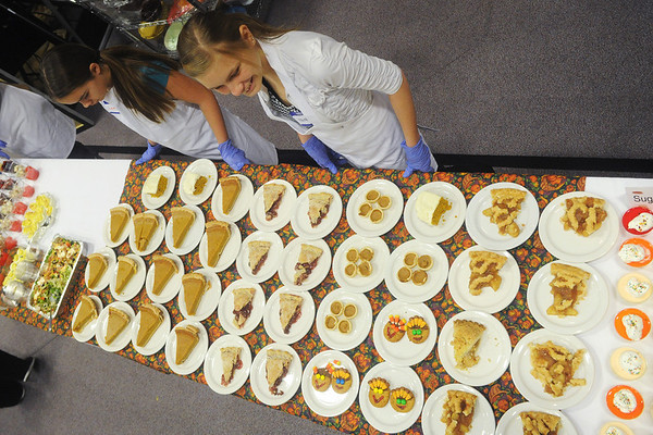 Globe/Roger Nomer<br /> Laura Anderson, 11, left, and Elaina Warren, 18, look after the dessert table at First United Methodist Church on Thursday afternoon.