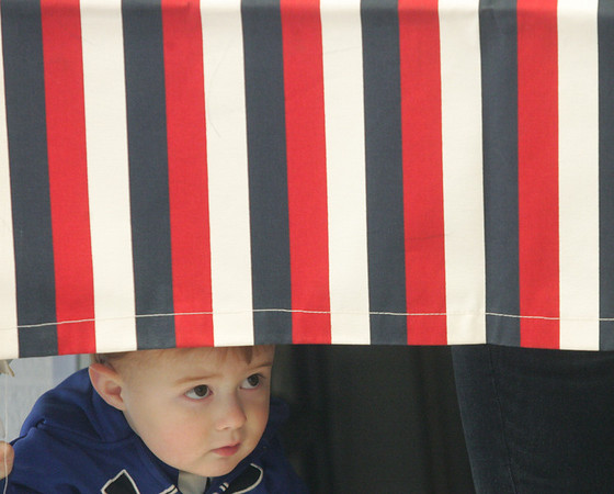 Globe/Roger Nomer<br /> Chandler Lorimer, 2, Galena, peeks out under the voting curtain while at Galena City Hall with his mother Jamie on Tuesday morning.