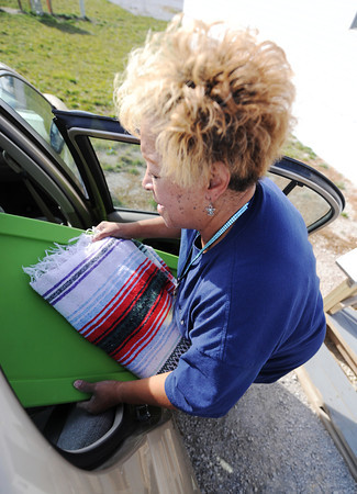 Globe/T. Rob Brown<br /> Flo Taylor, of Joplin, loads a tote full of belongings into her car from her FEMA mobile home Thursday morning, Nov. 29, 2012. Taylor was nearing the final stage of moving out to her own home Thursday.