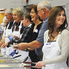 Globe/Roger Nomer<br /> Karen Layne, Joplin, welcomes visitors to the Thanksgiving meal at First United Methodist Church on Thursday.