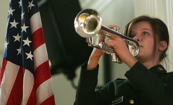 Globe/Roger Nomer<br /> JROTC Cadet Juliette Woodruff, freshman, plays taps during Friday's Veterans Day ceremony at the Joplin High 9/10 Campus.