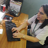 Globe/Roger Nomer<br /> Linnea Hanshaw, emergency service specialist, works at the Lafayette House on Wednesday morning.