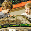 Globe/T. Rob Brown<br /> Five-year-old Joplin cousins Christopher Hoagland, left, and Andrew Howard watch a model train display Friday night, Nov. 30, 2012, following the unveiling of the Joplin City Hall window displays. The trains are sponsored by the Tri-State Model Railroaders.