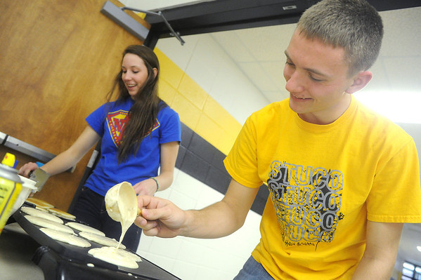 Globe/Roger Nomer<br /> Kyleigh Copley and Davy Blair, both seniors at Diamond High School, make pancakes for a community breakfast at the school on Thursday morning.  Diamond High School students from the National Honor Society and Student Council held the breakfast to show their appreciation for the community's support.