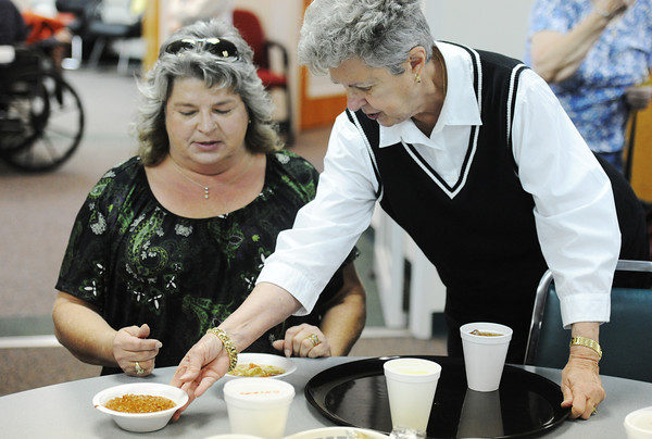 Globe/T. Rob Brown<br /> Doris Smith, of Joplin, right, Joplin Association for the Blind board member, serves a bowl of chili to Tamara Breedlove, of Joplin, during the association's annual Chili & Soup Feed Thursday, Nov. 8, 2012.