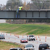 Globe/Roger Nomer<br /> High above Main Street, workers assemble the Zora overpass on Monday afternoon.