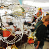 Globe/T. Rob Brown<br /> A wire angle decoration hangs from a tree full of angels (wire and ribbon styles) Saturday morning, Nov. 10, 2012, during the St. Philips Episcopal Church's bazaar.