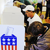 Globe/T. Rob Brown<br /> Voters hit the polls in numbers at the Saginaw Baptist Church polling location for the November 2012 election.