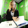 Globe/T. Rob Brown<br /> Olivia Patterson, 13, of Riverton, Kan., a Riverton Middle School student, looks through her itenerary for the upcoming Colonial Experience 2012 trip while packing Wednesday afternoon, Nov. 28, 2012, in her bedroom. Patterson was one of 10 Riverton students chosen, based on an essay about freedom and what it means to each student, to go on the trip to historical East Coast locations in Philadelphia and Washington, D.C.