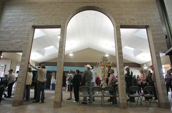 Globe/Roger Nomer<br /> A line winds through St. Paul's United Methodist Church as voters wait their turn on Tuesday afternoon.