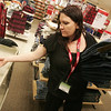 Globe/Roger Nomer<br /> Amber Failla stocks jeans on Monday morning at Sears in preparation for Black Friday.